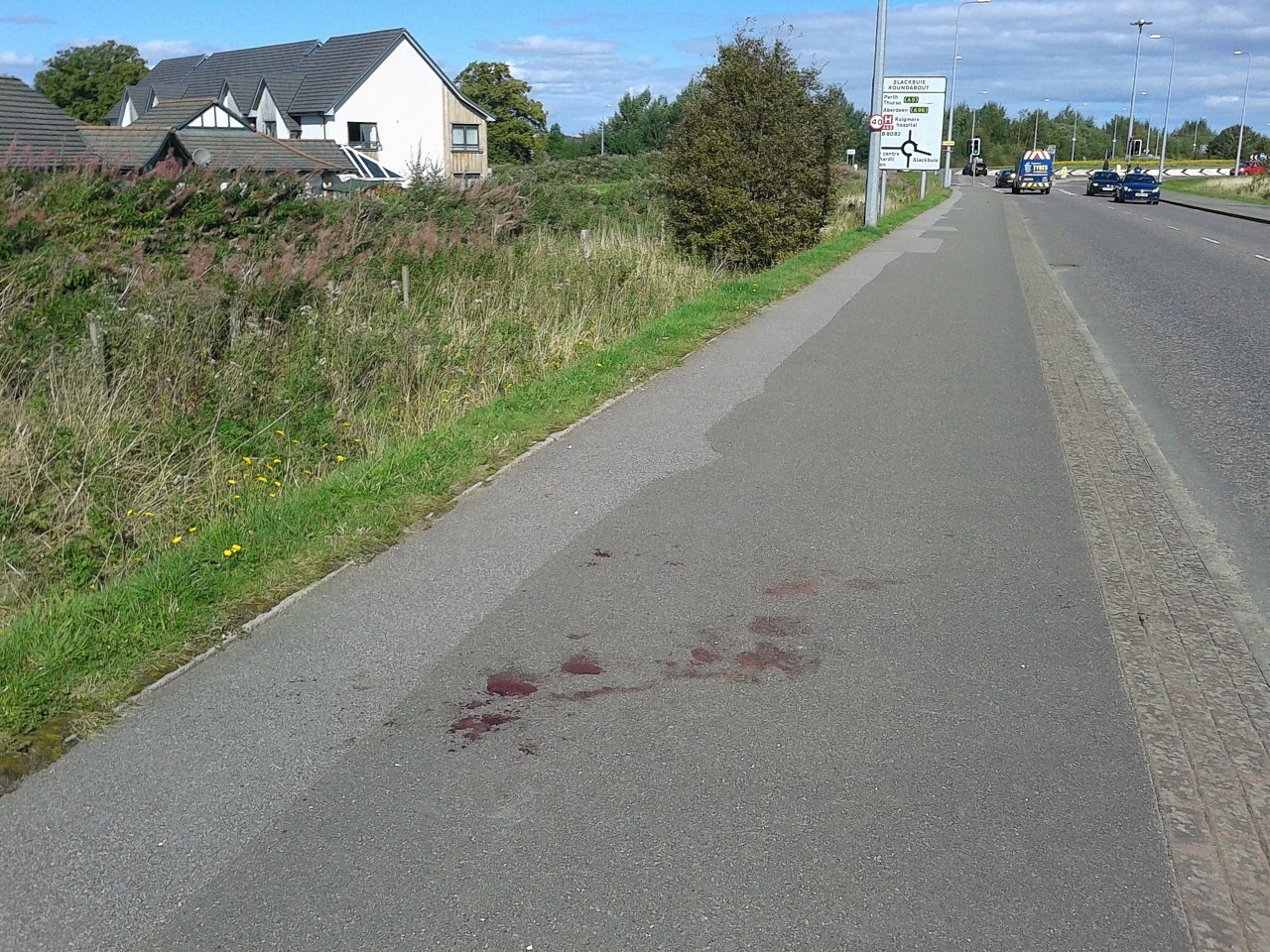 Blood left on the road following the incident in Inverness