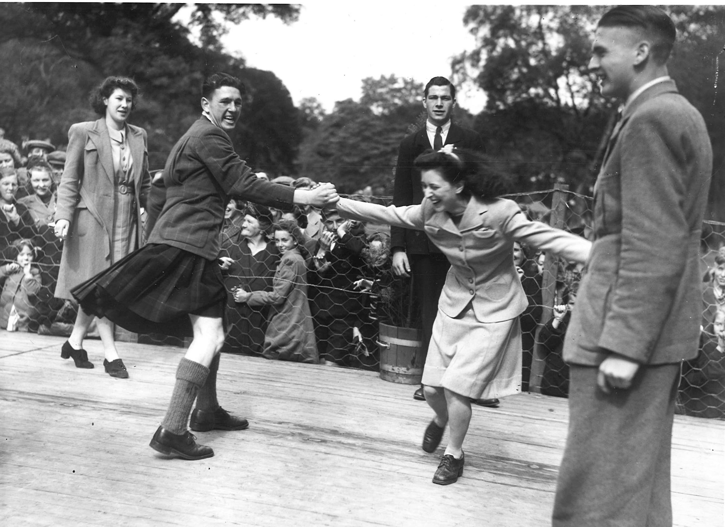 Stay at Home Holidays. Events were staged to help distract war woes. Fun during the eightsome reel at Hazlehead park summer 1942