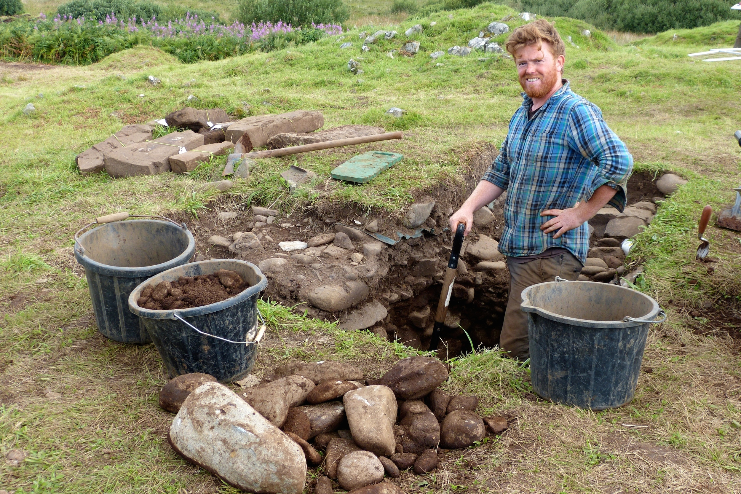 Archaeologist Paul Murtagh excavating the Bronze Age burial cist in which the remains of at least two bodies were found