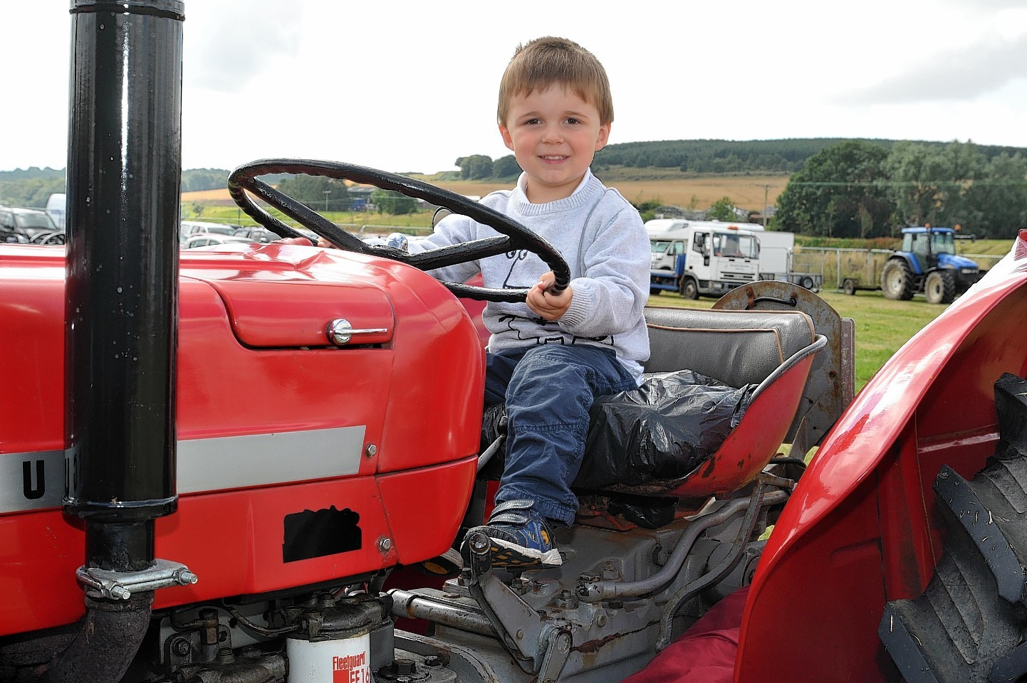 Lewis Donald (3), sitting on a tractor at the Turriff Show