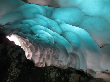 The underside of an almost translucent snow tunnel on Ben Nevis