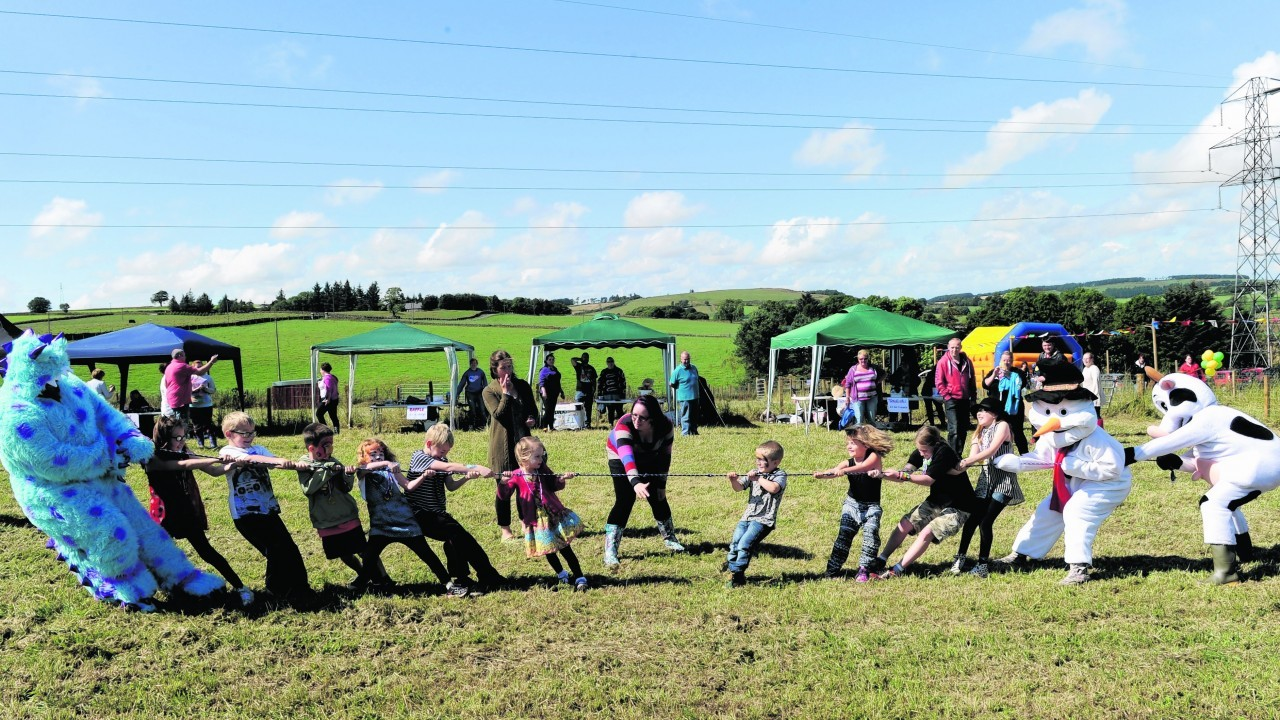 Tug o war at the Granite City Roller Girls' Mini Fete Day Fundraiser at Wynford Farm Café and Playbarn.