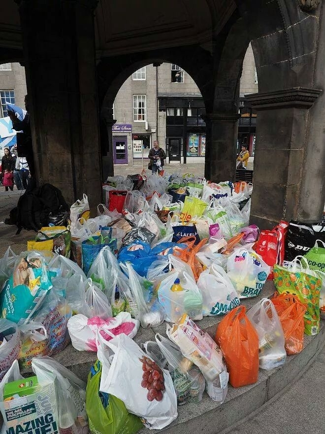 Food donations in the Mercat Cross,  Castlegate. Credit: Yes Aberdeen.