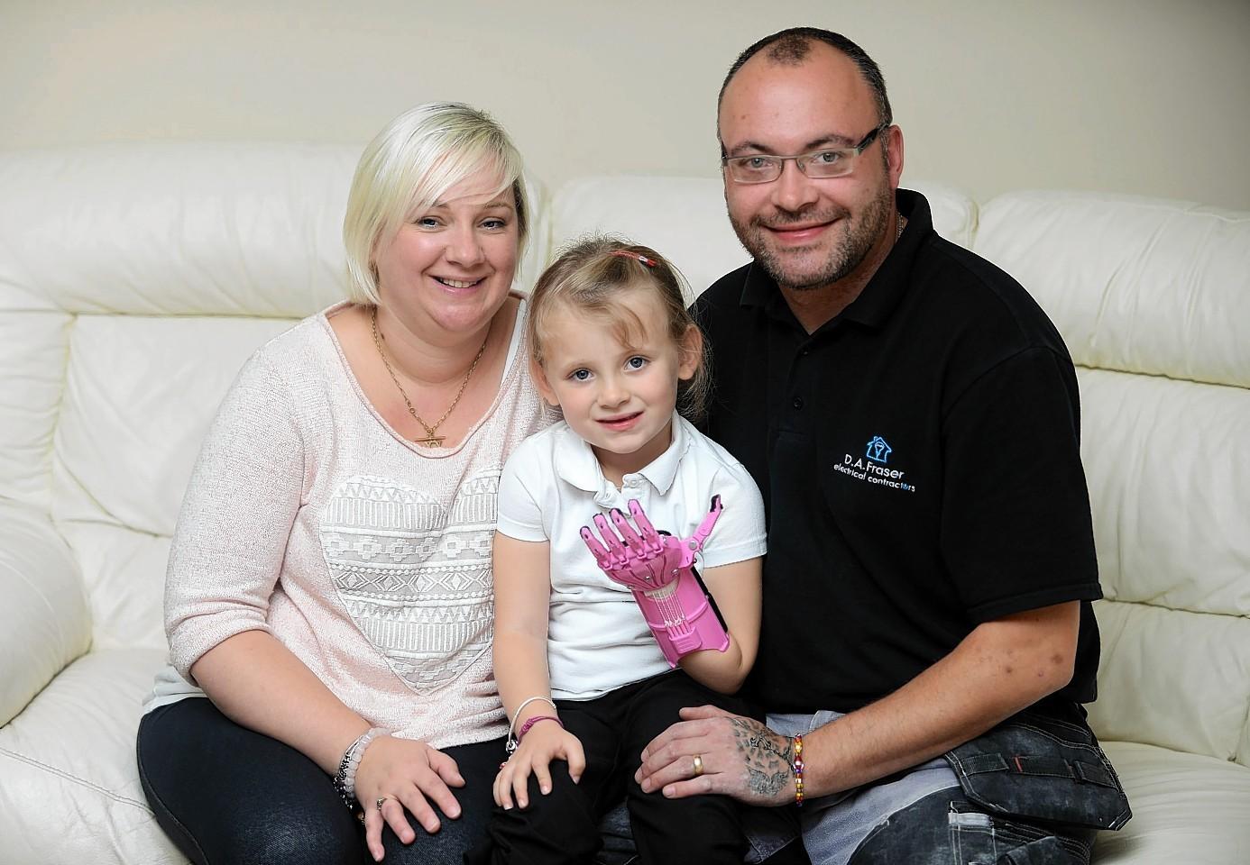 Haley Fraser with her parents