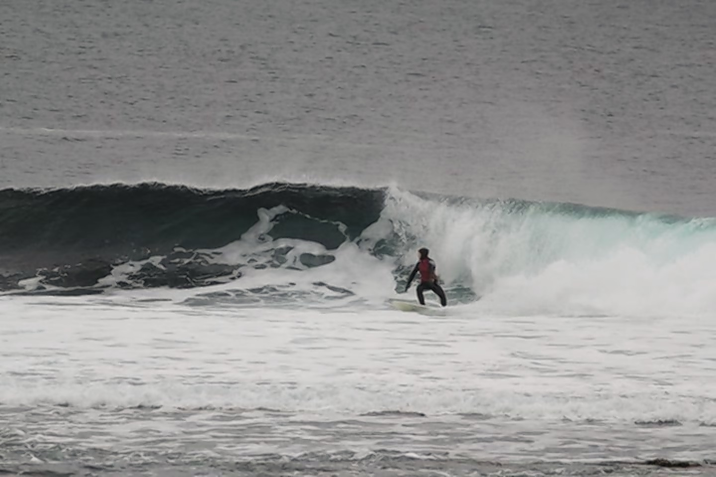 Surfer Jennifer Wood riding the waves near Thurso.