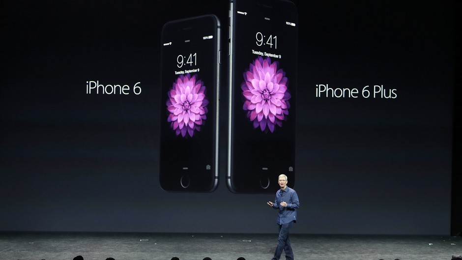 Apple CEO Tim Cook introduces the new iPhone 6 and iPhone 6 Plus (AP)