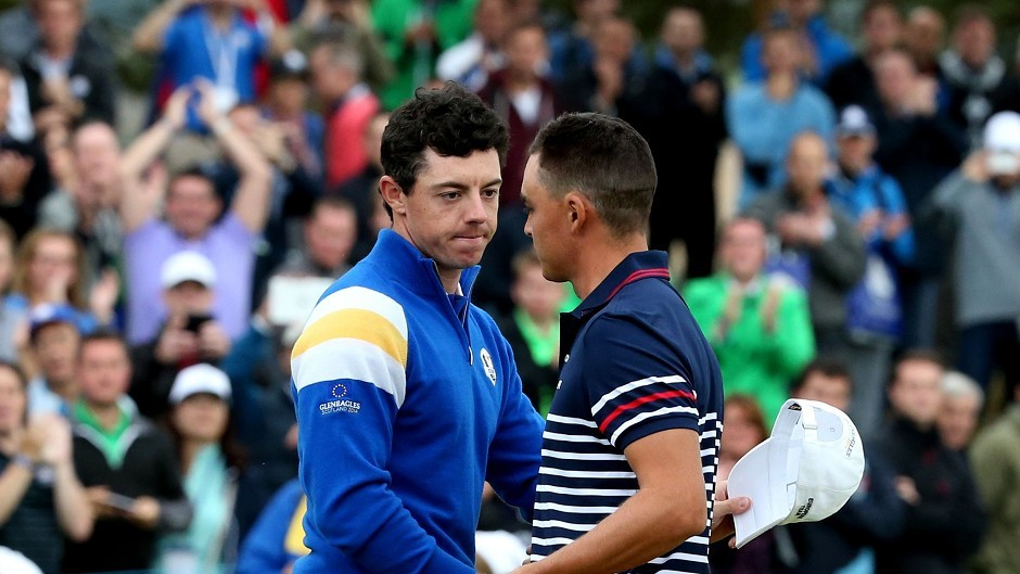 Europe's Rory McIlroy (left) shakes hands with USA's Rickie Fowler after their singles match on day three of the 40th Ryder Cup at Gleneagles