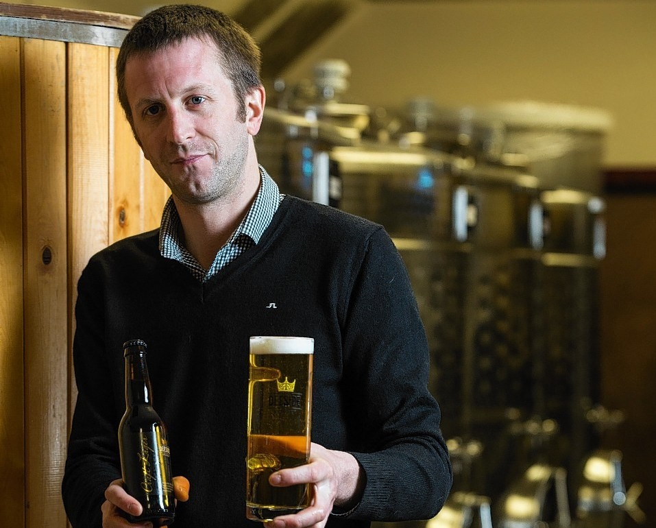 Neil Stirton, sales manager at Deeside Brewery, with a bottle of Craft Lager