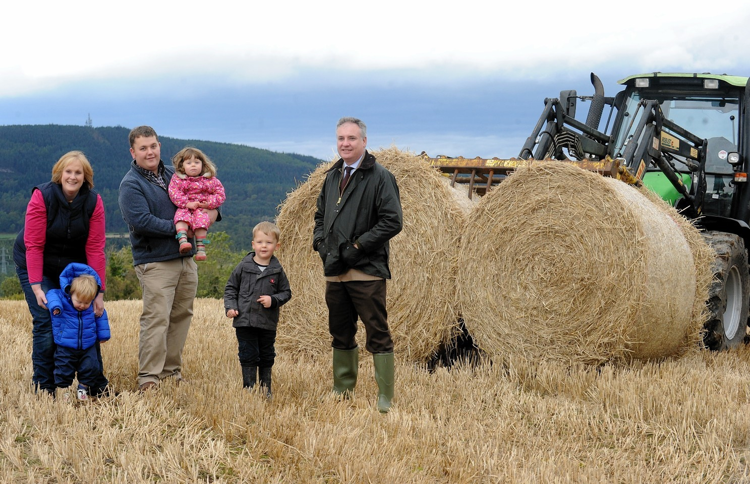 The Bennie family with farm minister Richard Lochhead