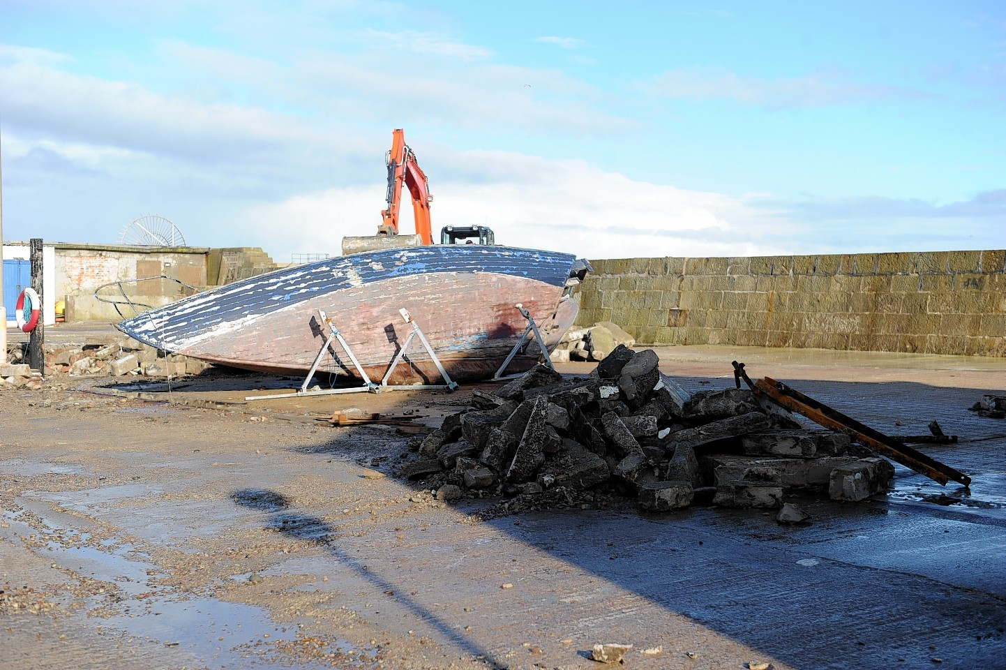 The flooding clean up begins at Lossiemouth where a boat was knocked over by the waves