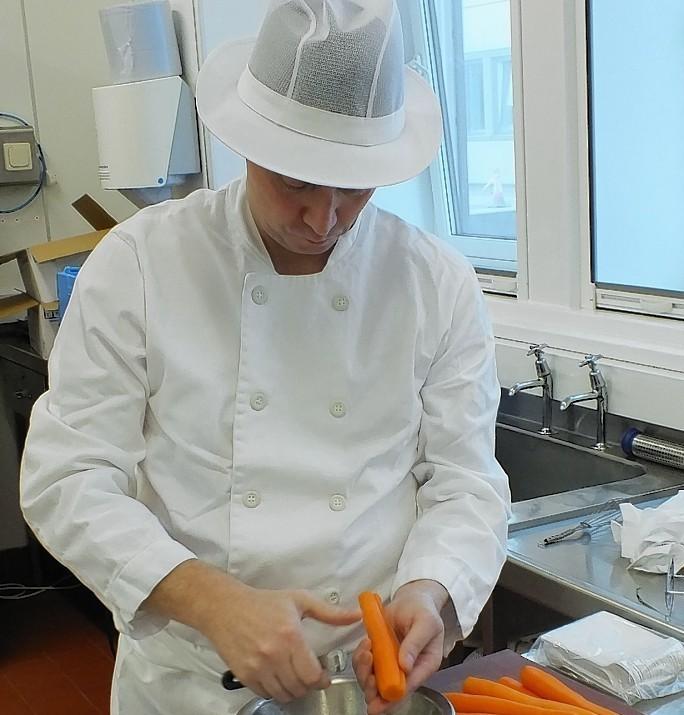 Graham Stewart prepares food