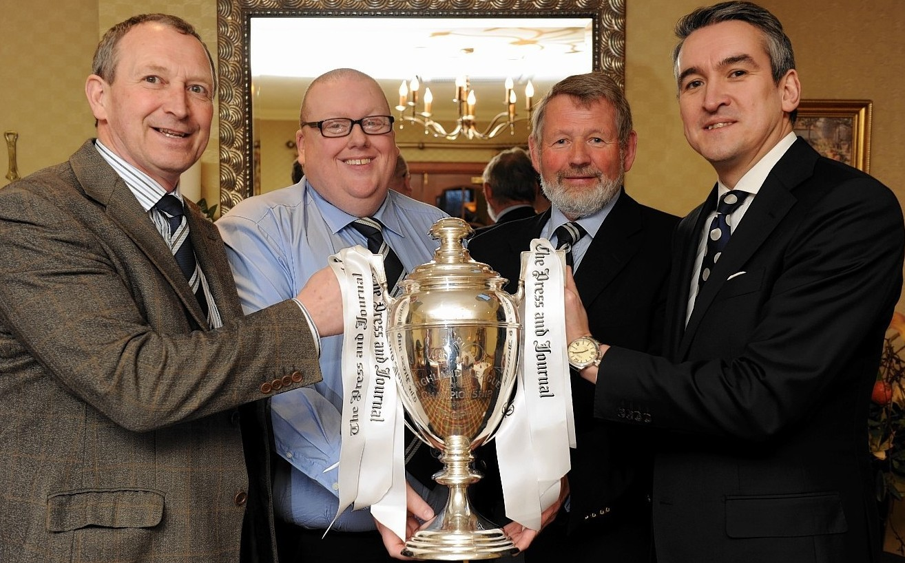 Willie Lippe, Finlay Noble, John Grant and Press and Journal Editor-in-Chief Damian Bates show off the Highland League trophy