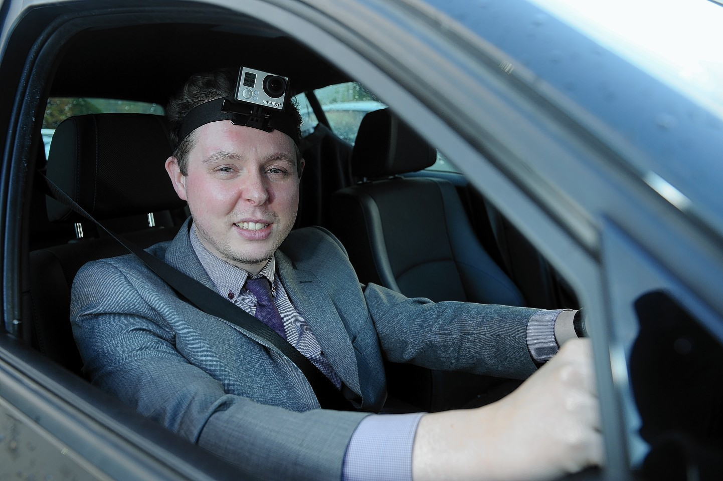 Martin Little dons a head-mounted camera to film the progress of his journey on the A9 yesterday