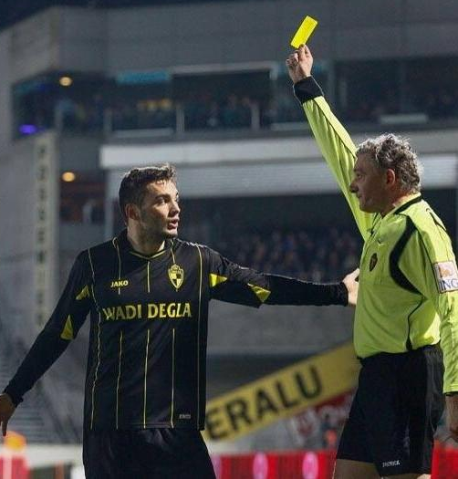 Tony Watt picks up a booking while playing for Lierse