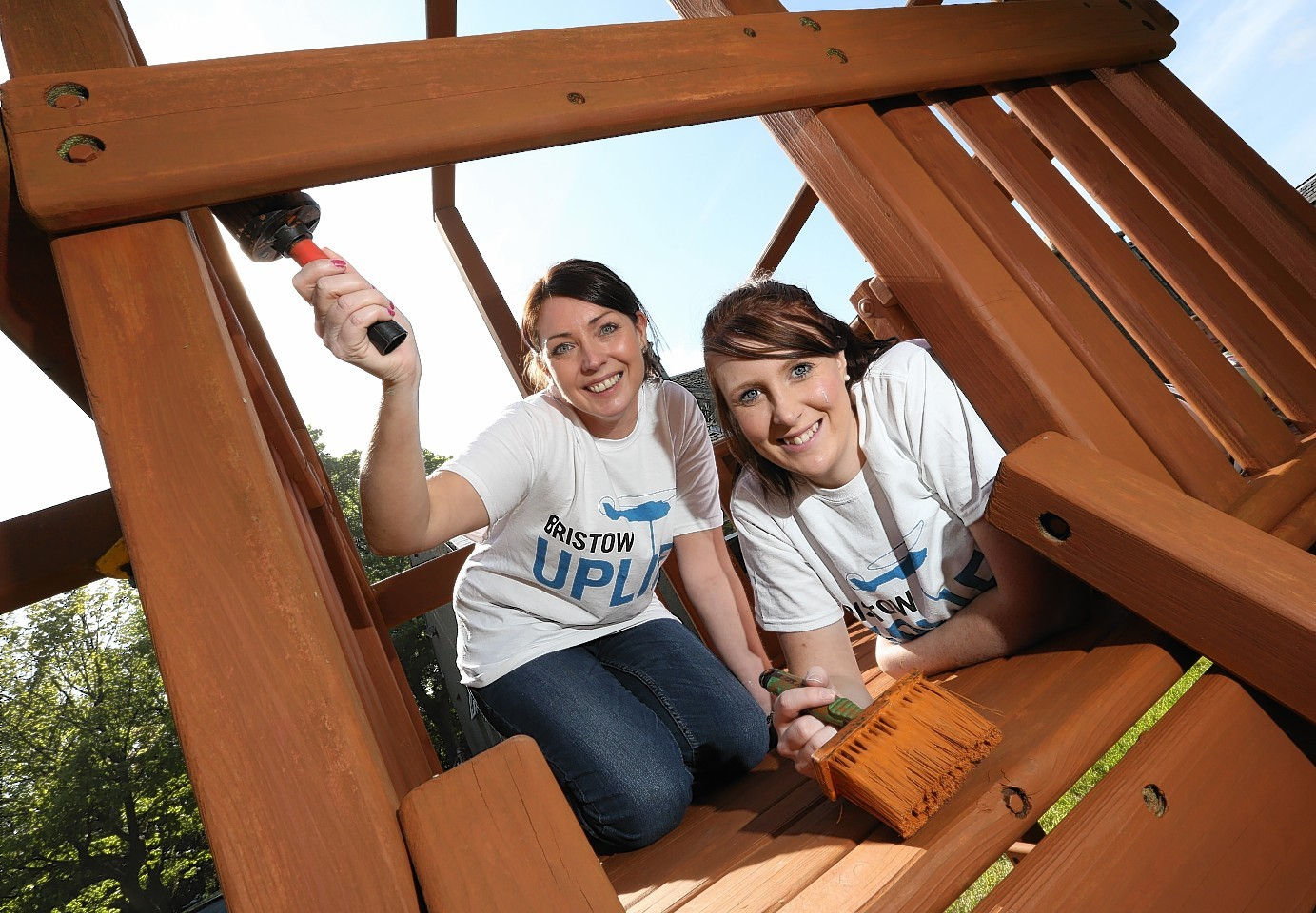 From left to right: Samantha Lewis and Lisa Clyne enjoy a day of volunteering at Aberlour's family service centre in Old Aberdeen