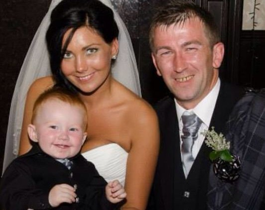 Mr and Mrs Dawson with Carter on their wedding day