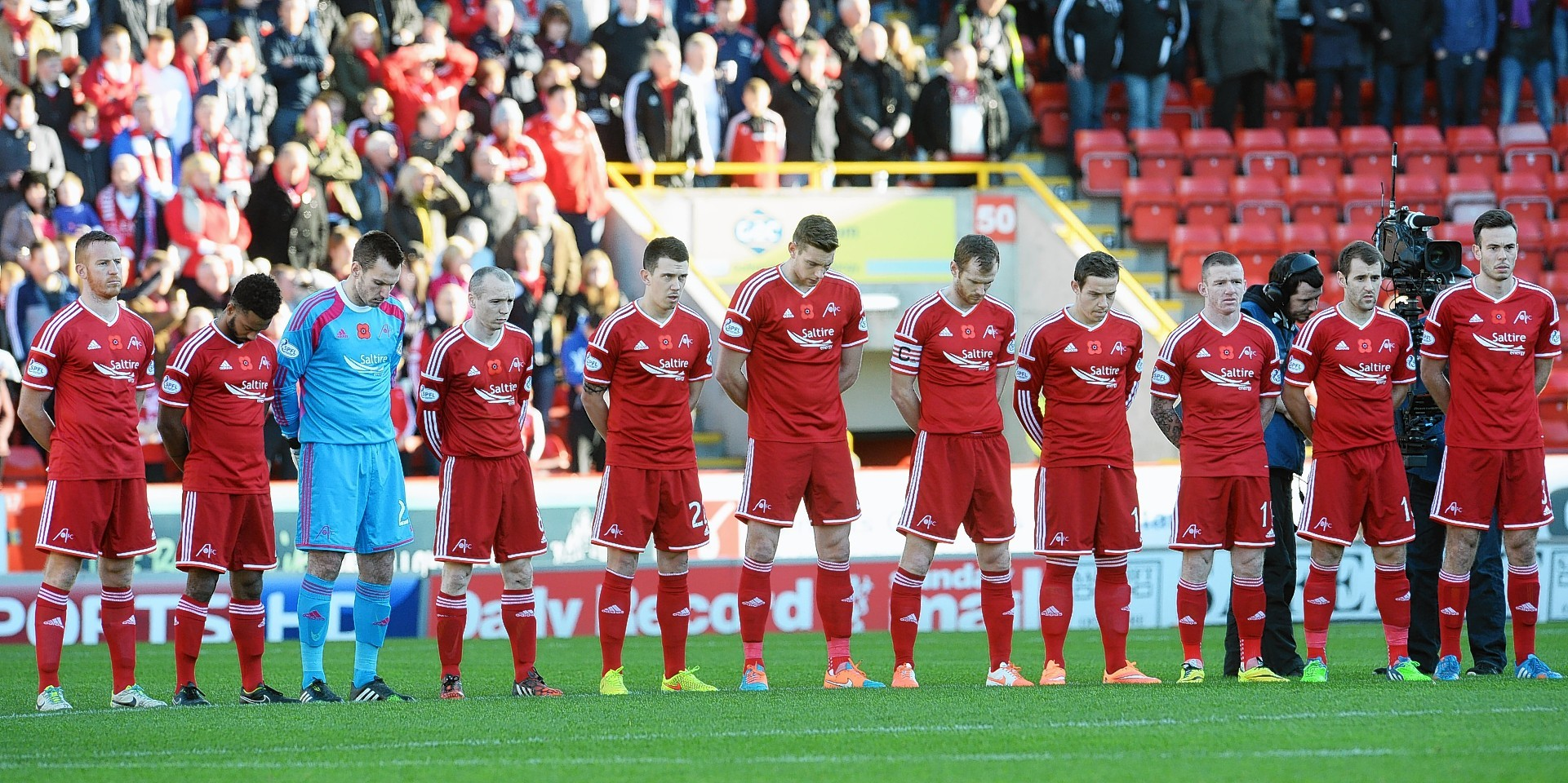 Aberdeen players observe the minute silence at Pittodrie
