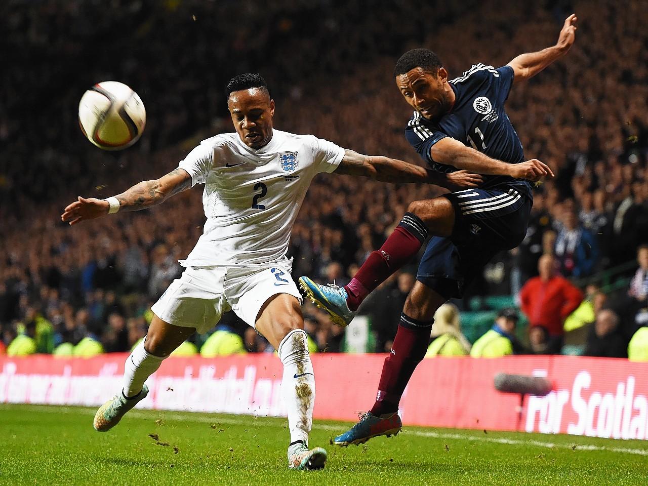 Ikechi Anya takes on England right back Nathaniel Clyne