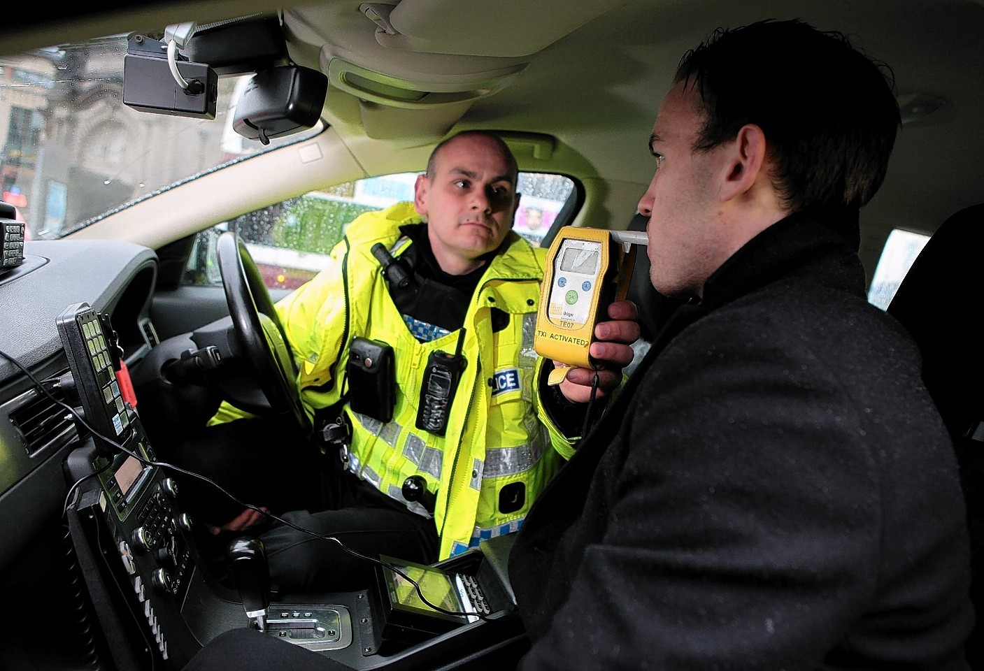 Stock image of police using breathalyser.