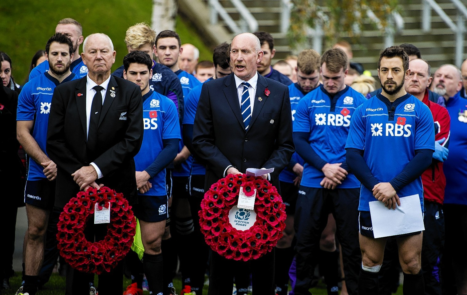New Zealand Rugby President Ian MacRae, SRU President Iain Rankin and Scotland Captain Greig Laidlaw pay their respects to the fallen British soldiers next to War Memorial at Murrayfield.