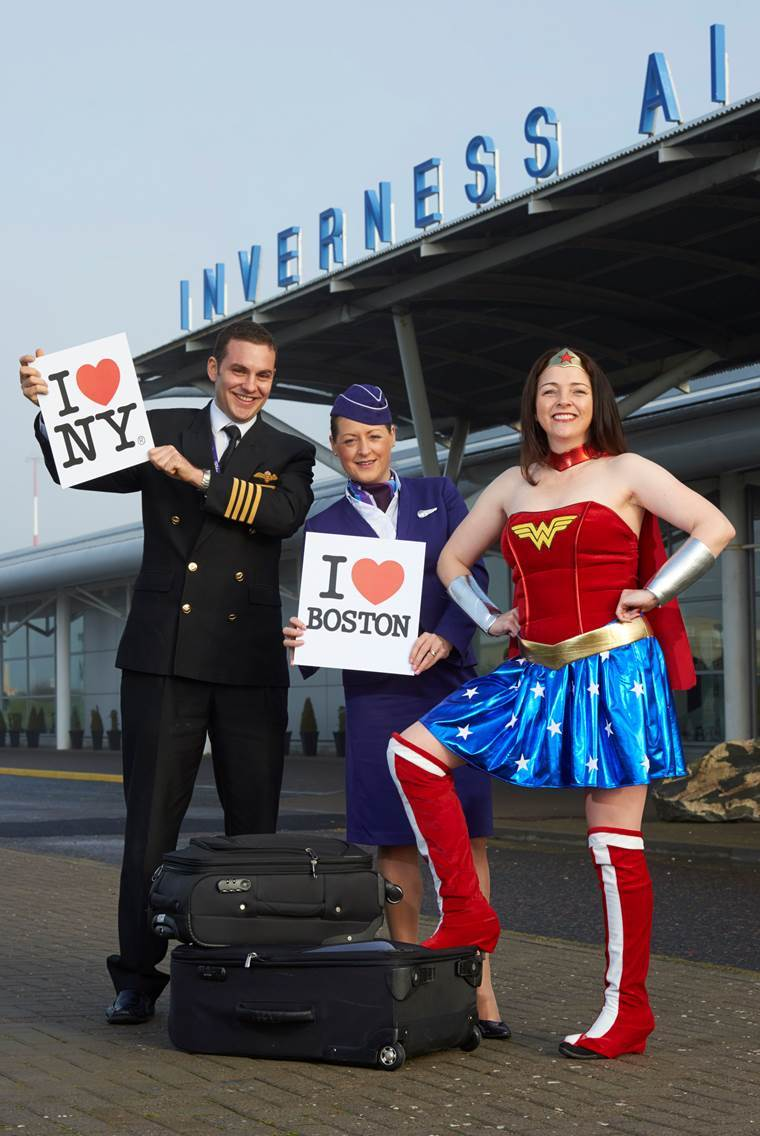 Flybe captain Tom Ross and senior cabin attendant Nicola Jansen van Rensburg pose with Wonder Woman