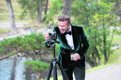 David Beckham sets up the camera whilst filming in Ross-shire