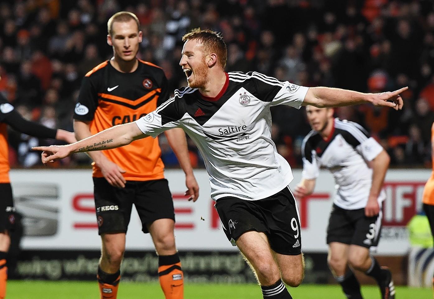 Adam Rooney celebrates his double