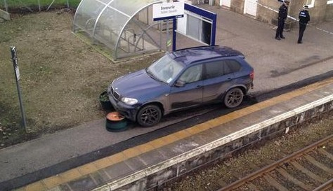 One of the cars involved was left crashed at Inverurie Train Station.