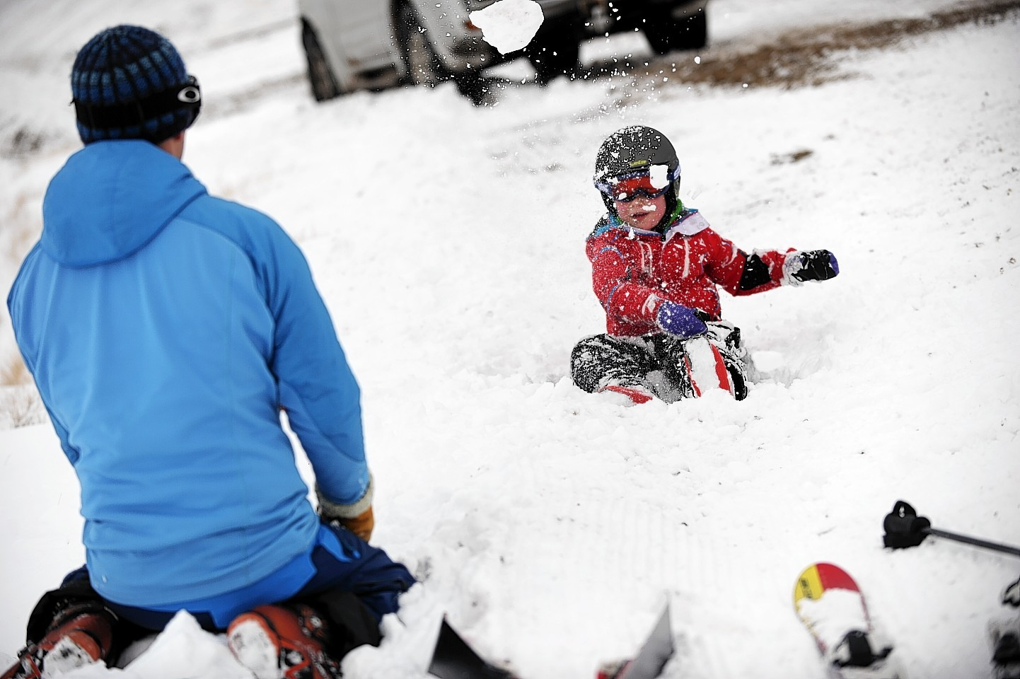 Paul Easto, takes a break from skiing at the Lecht to play in the snow with his son, Euan