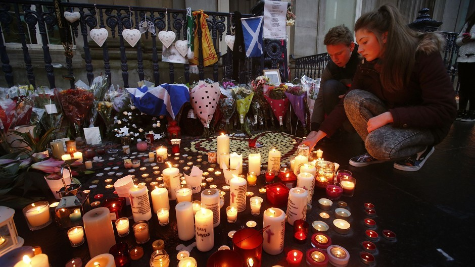 Candles are lit in Royal Exchange Square, adjoining Queen Street, in Glasgow, to remember victims of the bin lorry crash