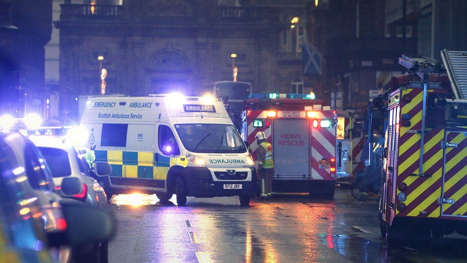 Emergency services deal with the aftermath of the crash in Glasgow.