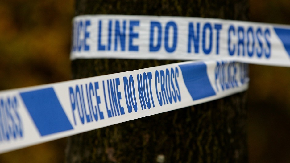 Police have cordoned off the area where the woman was found