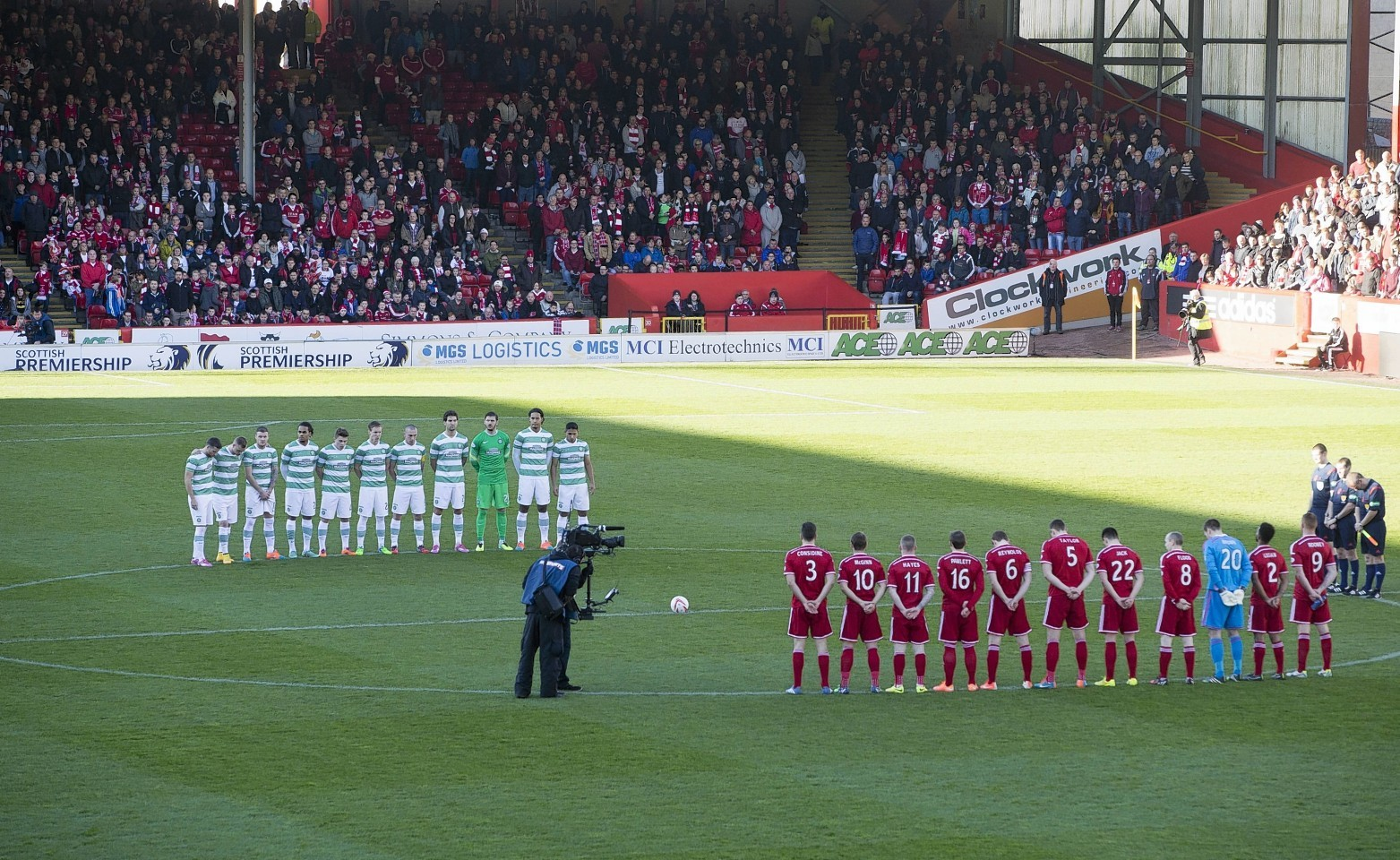 The players paid their respects before the match.