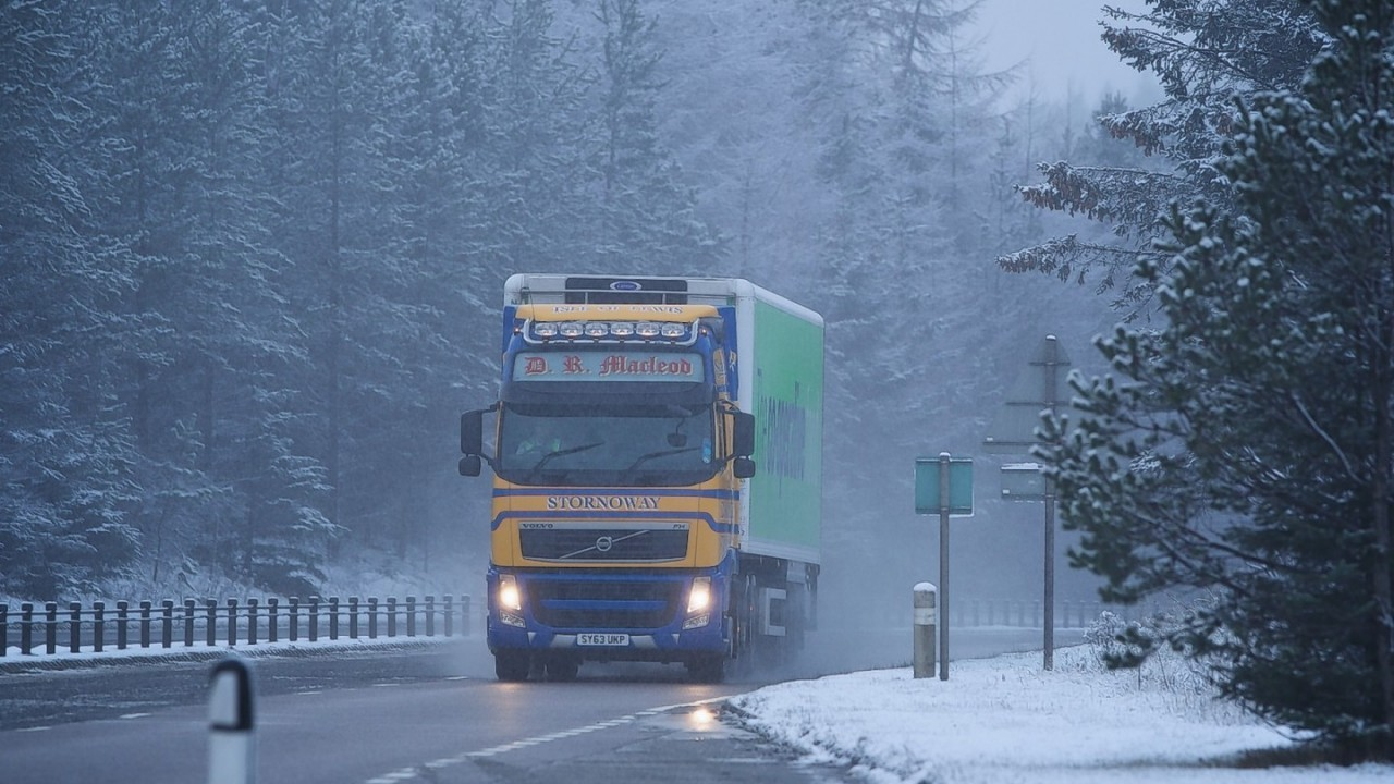 A lorry heads south through snow on the A9. Picture: Paul Campbell
