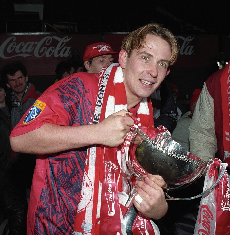 Billy Dodds lifted the Coca-Cola Cup with Aberdeen in 1995.