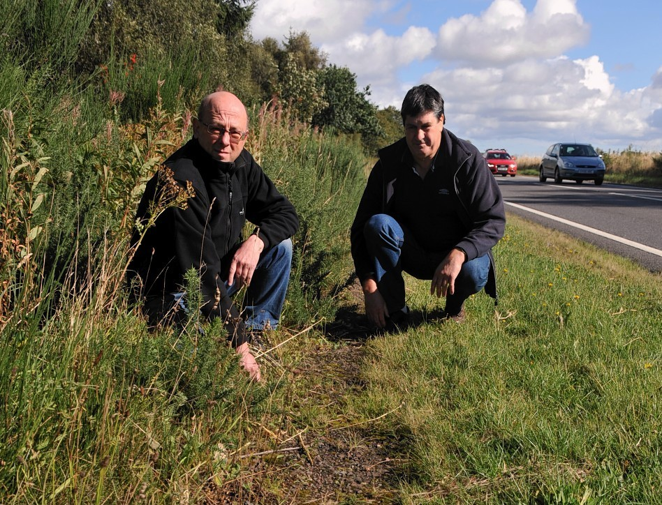 Campaign leaders Jim Rogers, left, and Neil Jeronim on the overgrown cycle path next to the A96, between Forres and Brodie