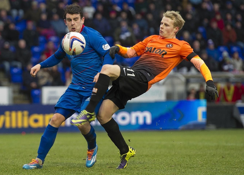Aaron Doran and Gary Mackay Steven challenge for the ball
