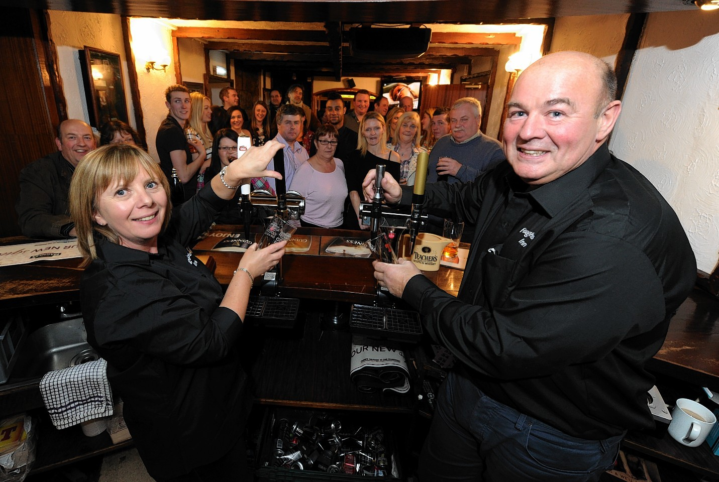 The Feughside Inn reopened following a two year closure last night. Pictured are new owners, Catherine and Donald Callander. Credit:  Kenny Elrick.