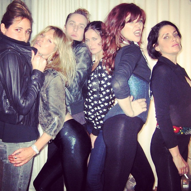Kate Moss (second from left) with several other celebs, including Sadie Frost (far right) and James Brown (middle left)
