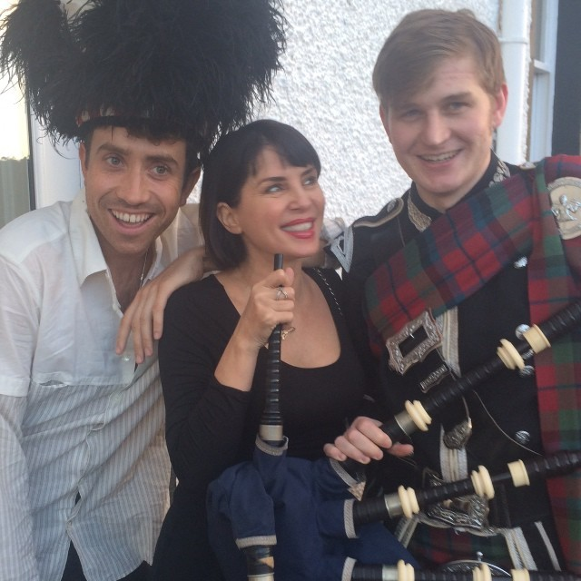 Sadie Frost poses with Nick Grimshaw and a piper outside the hotel