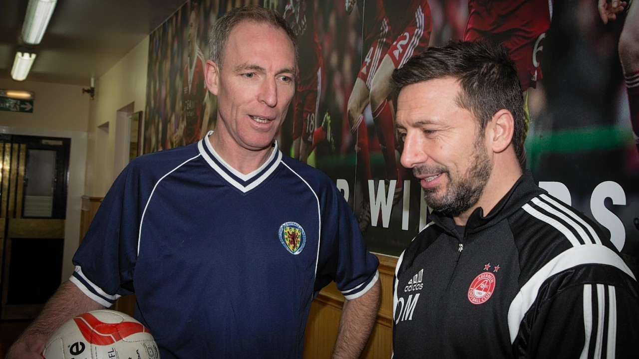 Jim Murphy talks to Aberdeen boss Derek McInnes