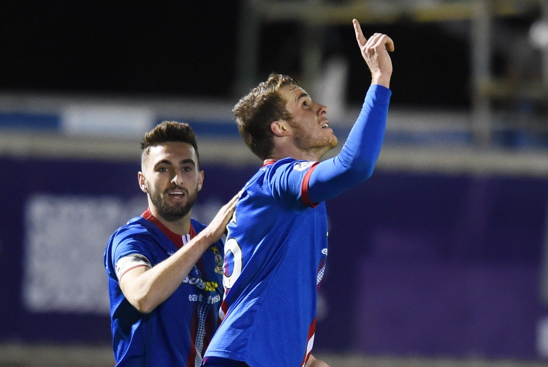 Marley Watkins celebrates Caley Thistle's second of the evening, set up by Tremarco