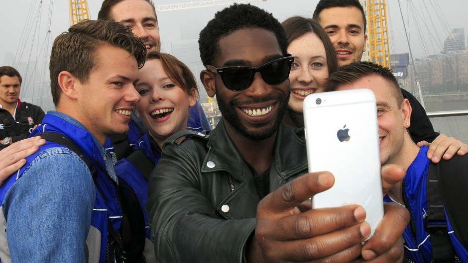 Tinie Tempah takes a selfie with fans at The O2 arena in London