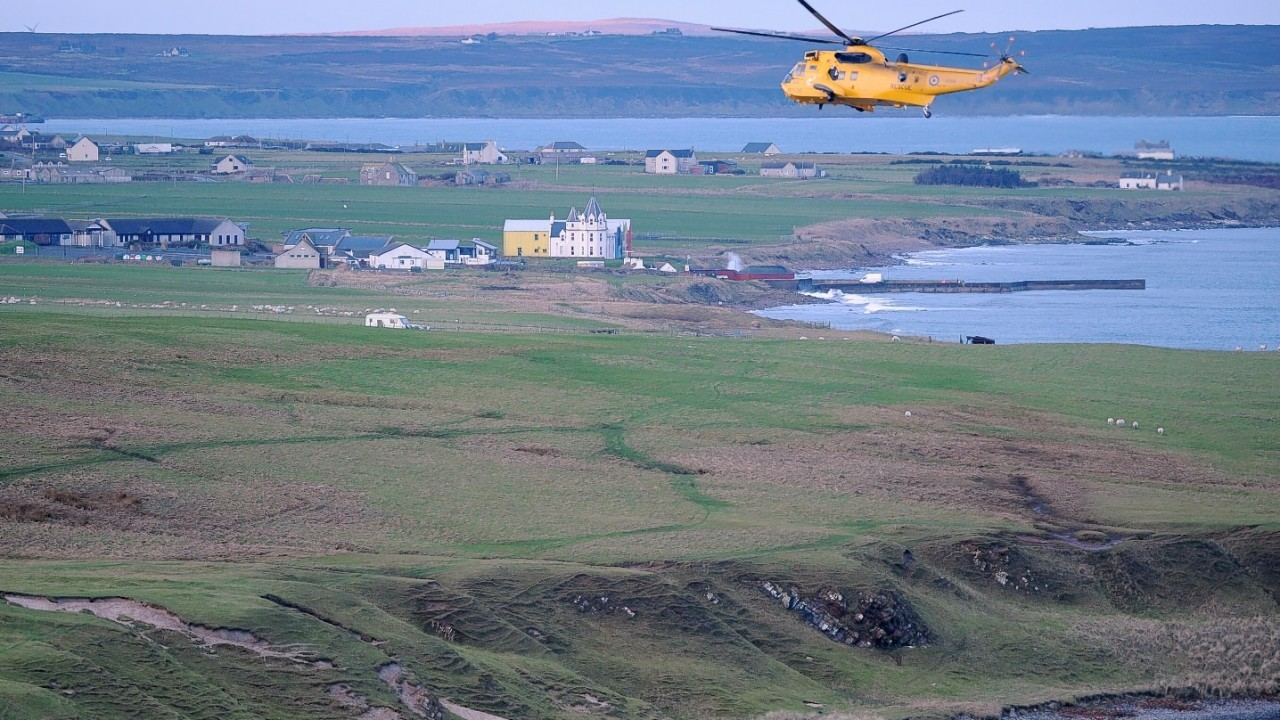 An RAF helicopter searches near John O'Groats