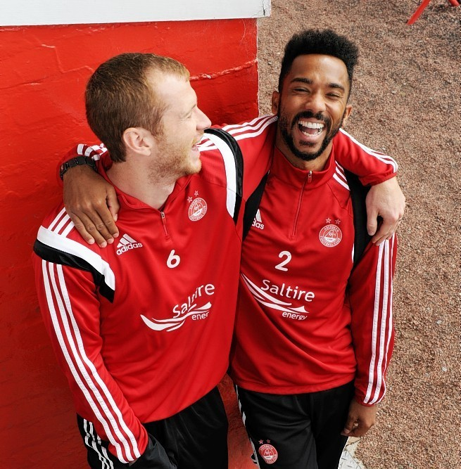 Mark Reynolds and Shay Logan will both start for the Dons but who should join them at the back?