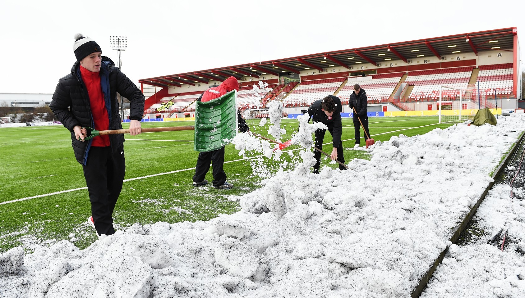 Hamilton Accies v Celtic: Fans cleared snow from the pitch prior to kick off at New Douglas Park