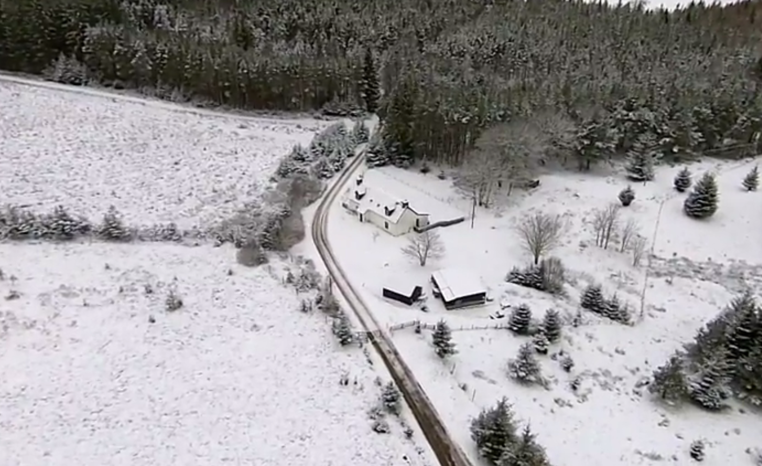 A drone video has captured snowy scenes in the Highlands