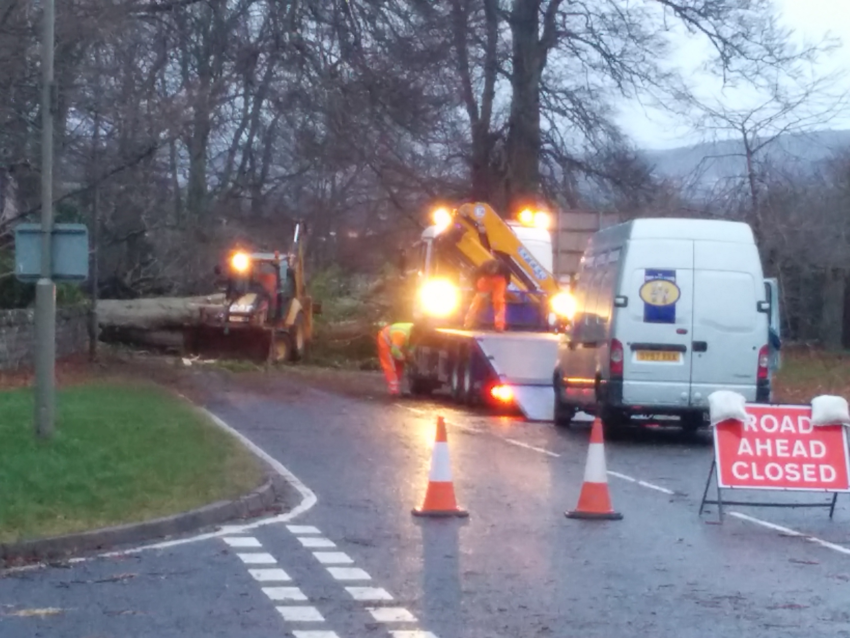 Workers attempt to clear a fallen tree at Culloden Road in Inverness