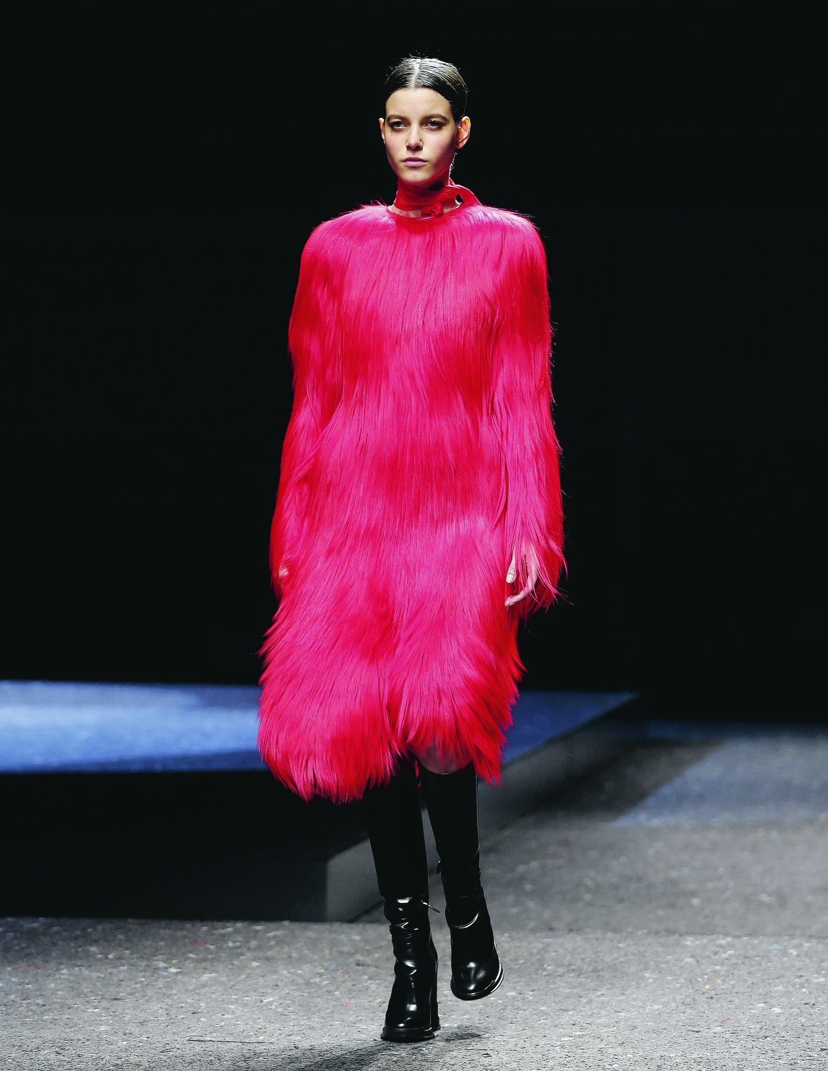 a model wearing a creation for Prada women's Fall-Winter 2014-15 collection, part of the Milan Fashion Week