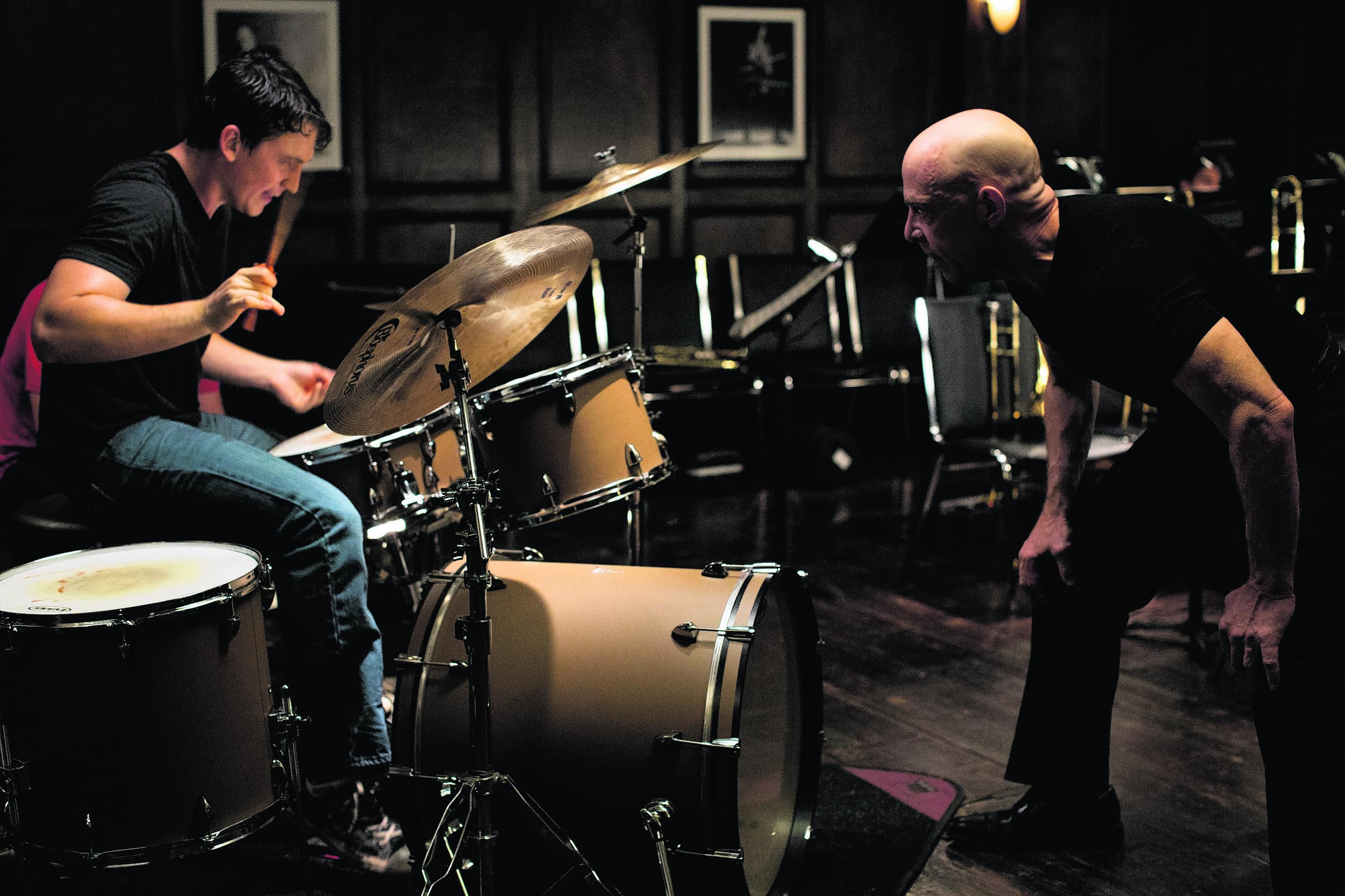 Miles Teller, left,  as Andrew Neiman, and J.K. Simmons as Terence Fletcher in Whiplash
